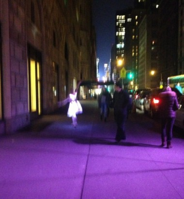 12-15 ballerina with a lit-up tutu twirling on Seventh Avenue just south of Central Park