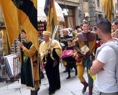 Afterwards, the winner (the young man at the right) leads a parade through town, while the lad at the center carries his trophy, a silver dagger, on a pillow.
