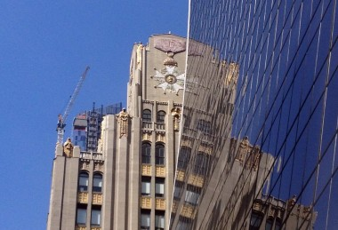 I'd never noticed the gilt detail at the top of this building on W. 57th Street before.