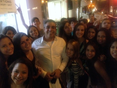 Carlos and a gaggle of Brazilian kids