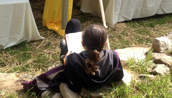 this 10-year-old just plunked herself down and read her book (SPEAK by Laura Halse Anderson, if you must know)
