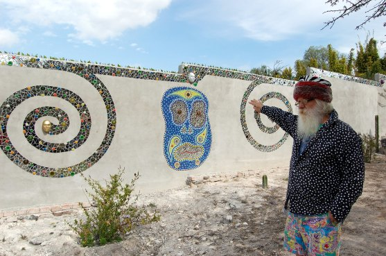 work-in-progress: along the garden wall, Anado is creating a long mosaic mural based on the Tarot deck