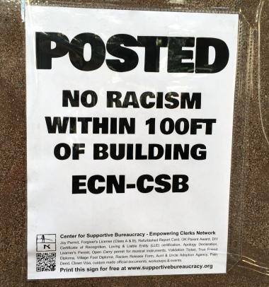 10-8-no-racism-sign